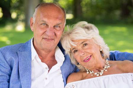 couples hug: Portrait of romantic elegant couple hugging in the park