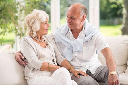 happy seniors: Tenderness in old age- senior happy couple in love