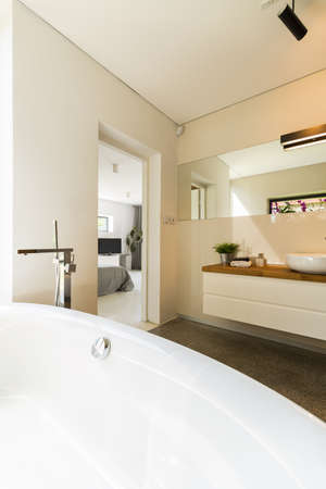 minimalistic: Shot of a minimalistic, modern bathroom with a large bathtub Stock Photo