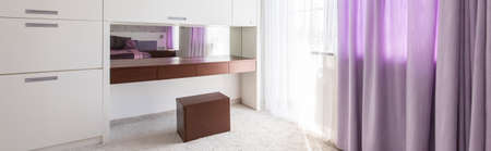 bedroom furniture: Stylish bedroom with white furniture, carpet and decorative purple curtains