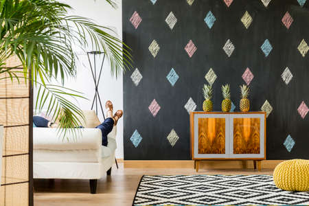 wall decor: Beautiful interior with blackboard, room divider, sofa, pattern carpet and exotic commode