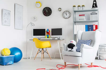 View on a part  of a child room with desk with two screens, chairs and toys Zdjęcie Seryjne