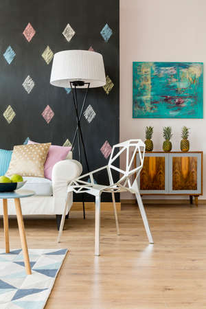 commode: New apartment with blackboard wall, sofa, floor lamp, crystal chair and exotic commode