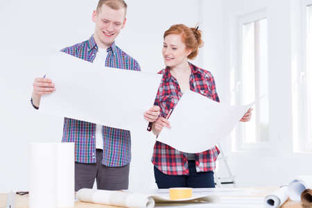 redecoration: Shot of a young couple decorating their new flat