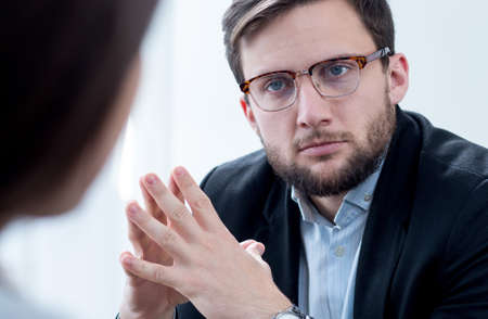 psychoanalysis: Image of doctor listening his patient with depression Stock Photo