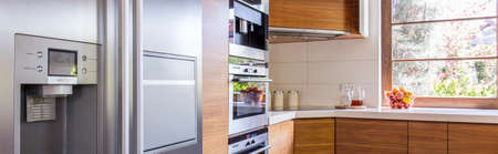 well equipped: Stylish well equipped kitchen with wooden furniture Stock Photo