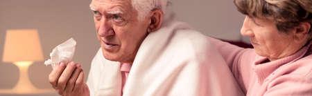 facial tissue: Senior man with facial tissue having a flu Stock Photo