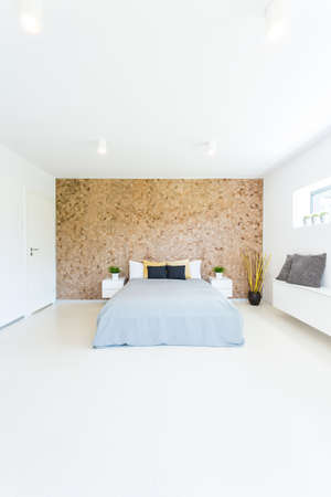 master bedroom: Shot of a minimalistic master bedroom with a wooden wall Stock Photo