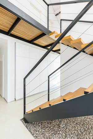 spacious: Shot of a modern stairs in a spacious apartment Stock Photo