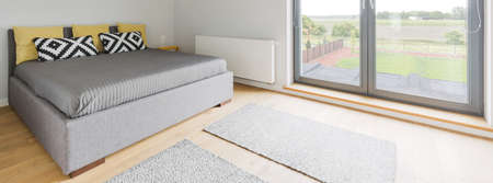 kingsize: Panoramic picture of a king-size bed in a spacious bedroom
