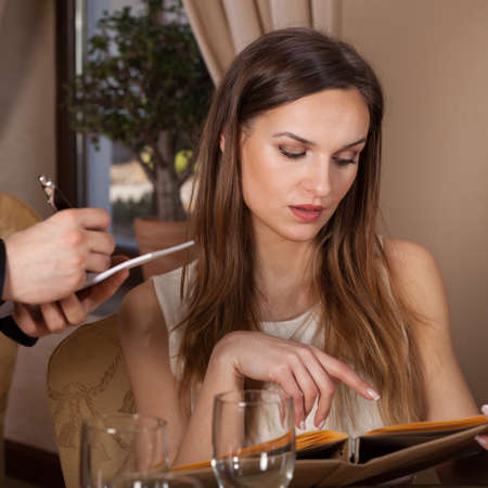 ordering: Woman ordering a meal in a restaurant Stock Photo