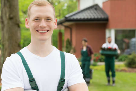 boiler suit: Blond  haired male gardener with crossed arms