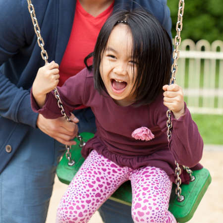 father daughter: Father spends time with his cute daughter on the playground