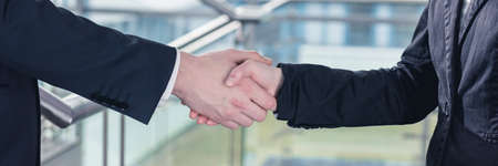 Close-up of handshake between two businesspeople after successful meeting Stok Fotoğraf