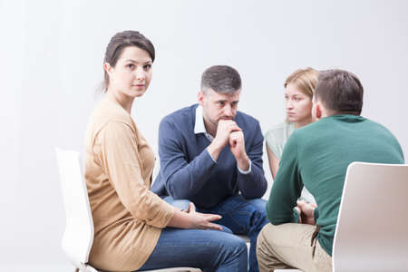 Shot of a young woman taking part in a meeting of a support group