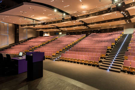 drop ceiling: Wide view of a spacious modern lecture hall with lighting fixture