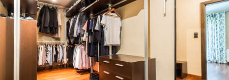 walk in: Banner view of a new design spacious walk in closet