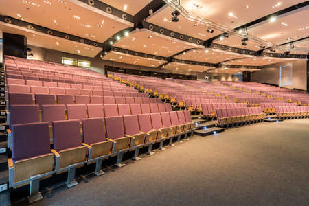 lighting fixtures: Side view of a very spacious lecture hall with lighting fixtures