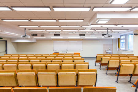 lightsome: Rear view of a classroom with desk of lecturer and whiteboard
