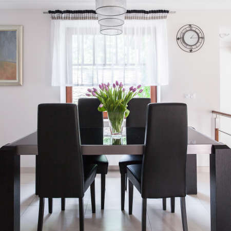 tasteful: Tasteful and sunny dining room in the house Stock Photo