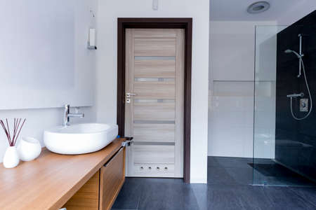 Cropped shot of a minimalistic bathroom with a spacious shower bath