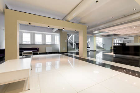 halls: Spacious waiting hall with high-polished tiled floor, tables and sofas