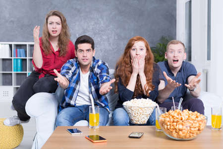 dissapointed: Shot of a group of dissapointed young people sitting on a sofa