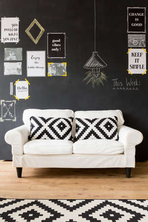 living room design: Shot of a beautiful white sofa with black and white patterned pillows