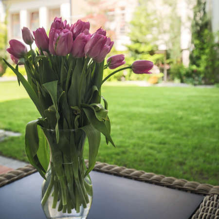 Bouquet of violet tulips on the table