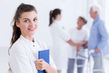cropped shot: Cropped shot of a smiling nurse holding a patient chart Stock Photo