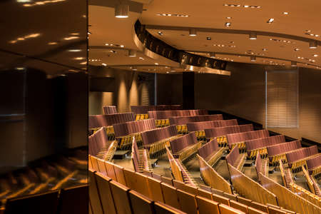 lecture theatre: Shot of modern auditorium with pitched floor and reflexions of light Stock Photo