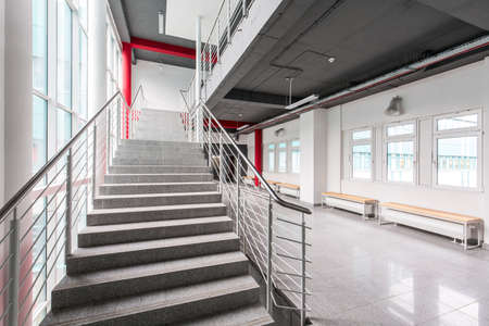 mezzanine: Marble staircase leading to the upper floor and a spacious lobby