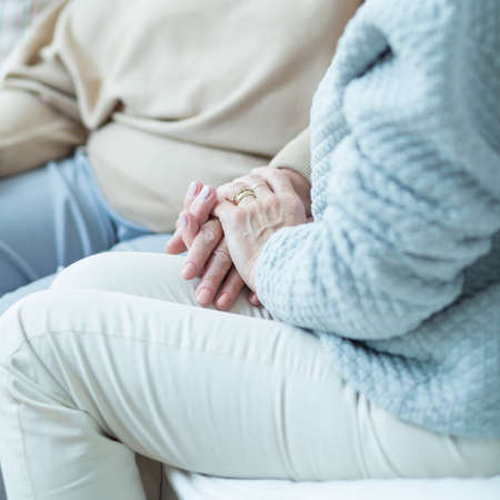 holding close: Close up of woman holding aged female hand