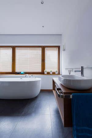 minimalistic: Shot of a minimalistic bathroom interior with an oval bathtub Stock Photo