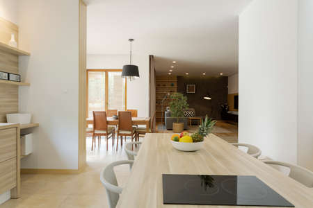 cropped shot: Cropped shot of a beautiful open kitchen area with a kitchen island Stock Photo