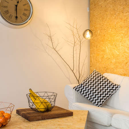 chipboard: Warm living room with white, linen sofa and chipboard wall