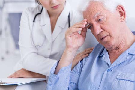 man doctor: Shot of a worried elder man receiving bad news Stock Photo