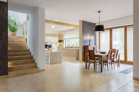 elegant design: Shot of a spacious interior with open, bright kitchen and a dining area