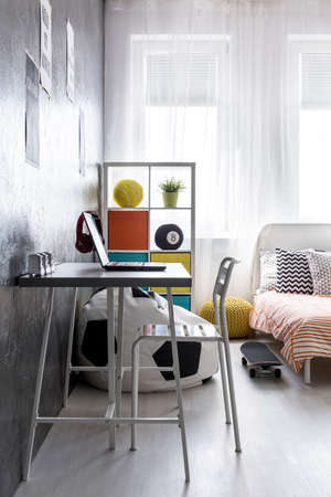 combining: Shot of a minimalistic teen room interior combining two areas