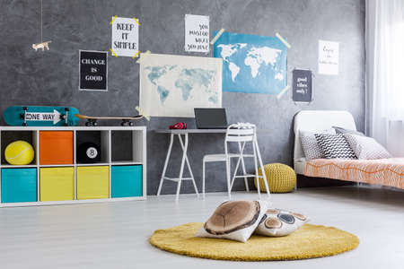 teen bedroom: Shot of a teen bedroom with colorful boxes inside white shelf