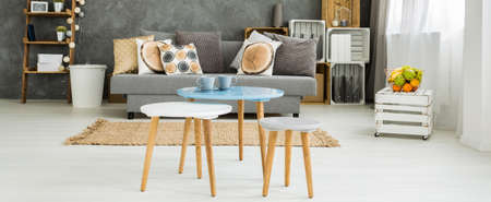 Set of coffee tables with cups of coffe in a cosy and functional apartment Stock Photo