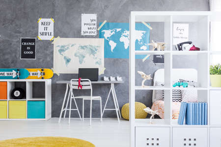 teen bedroom: Shot of a teen bedroom interior with a minimalistic place to work