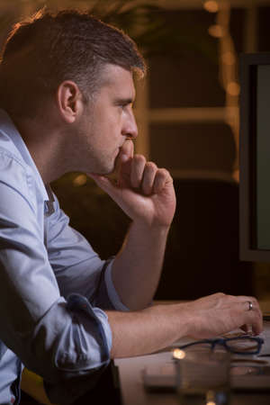 night shift: Shot of a thoughtful middle-aged man using his computer in the office