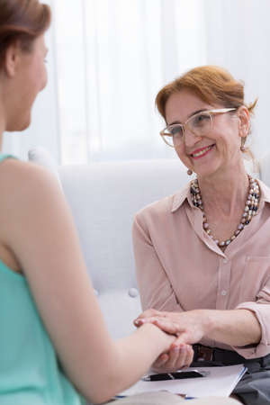 cropped shot: Cropped shot of a female patient expressing her gratitude to smiling therapist