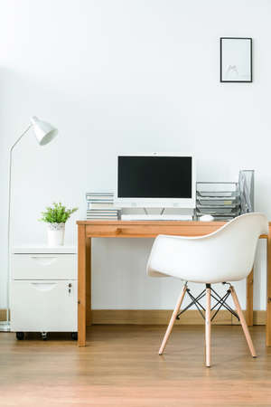 working space: Working space with a desk, chair and computer in a bright and calm room