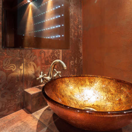 washbowl: Glass washbowl and modern mirror in luxury bathroom