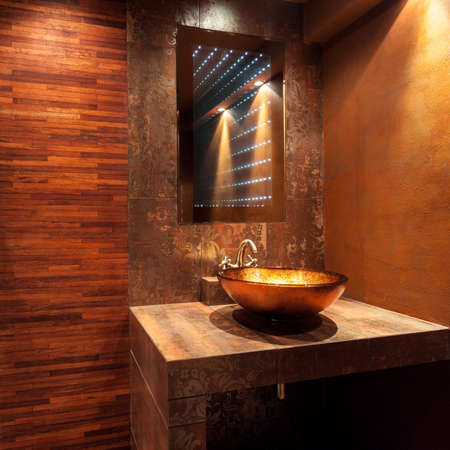 expensive: Interior of expensive bathroom with golden sink