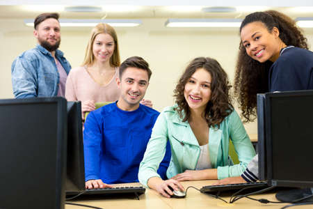 informatics: Young participants of the IT course  satisfied look ahead Stock Photo