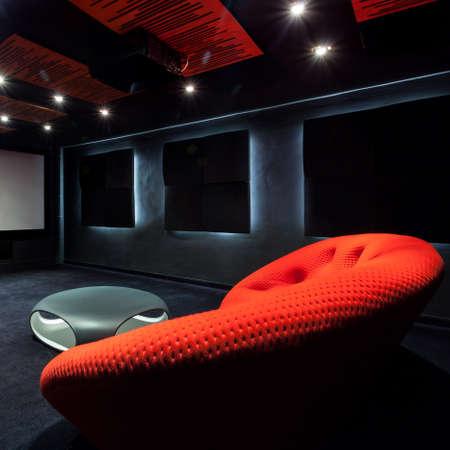 dark interior: Comfortable red sofa in a dark interior Stock Photo