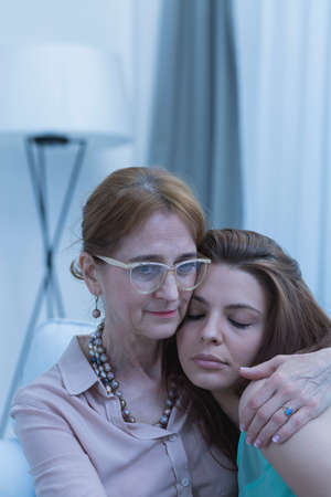 sympathize: Cropped shot of empathic doctor hugging her worried patient